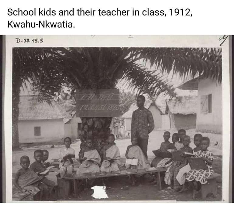 School kids and their teacher in class, 1912, Kwahu-Nkwatia