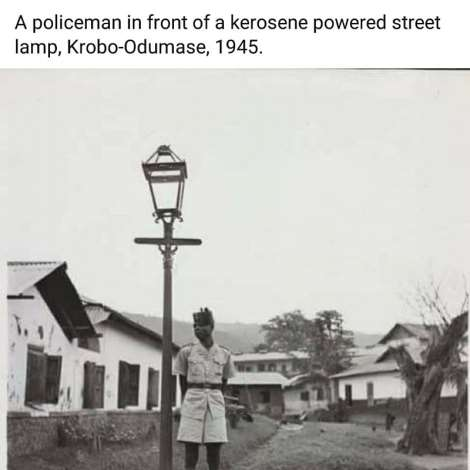 A policeman in front of a kerosene powered street lamp, Krobo-Odumase, 1945