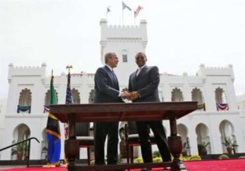 President Bush and Tanzania's President Jakaya Mrisho Kikwete shake hands after they signed the Millennium Challenge Compact at the State House in Dar es Salaam, Tanzania, Sunday, Feb. 17, 2008. (AP Photo/Charles Dharapak)