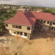 uncompleted 23 bedroom hostel for sale at oyibi