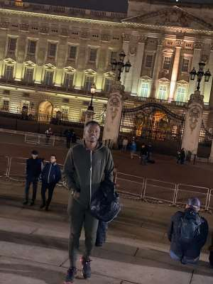 Ghanaian Journalist Attractive Mustapha interacts with Climate Change protesters at Buckingham Palace
