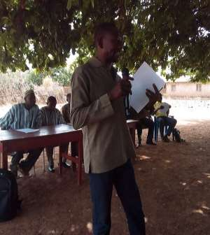 Abdul Rahaman Osman - the Daffima Bussie Issa District Director of NCCE addressing the gathering