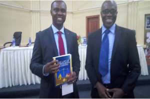 The Author[left] displaying the newly launched book