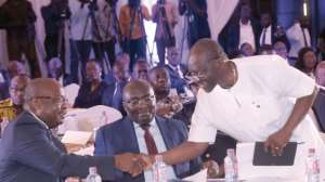 Mr Ken Ofori-Atta (right) shaking hands with Dr Ernest Addison as Vice-President Dr Bawumia looks on at the ceremony