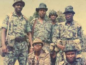 Besigye (L) and his comrades during the bush war