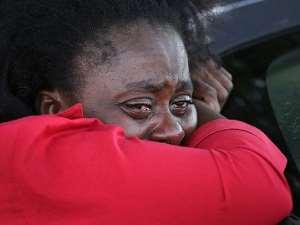 A woman weeps at Ebola treatment center