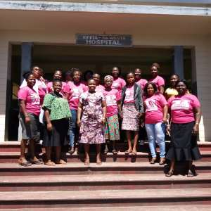 W/R: Group Of Health Workers Support Breast Cancer Patient