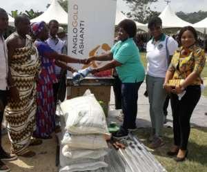 Mrs Rose Amoah, Senior Manager - Finance Donating the best female farmer award to Madam Amina Agyimah