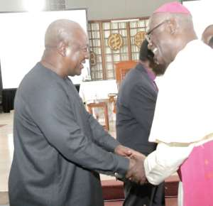 Former President John Dramani Mahama (left) exchanging pleasantries with Most Rev. John Bonaventure Kwofie, Metropolitan Archbishop of Accra at the 'Conversation in the Cathedral' held at the Holy Spirit Cathedral in Accra