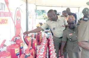 Personnel of the Fire Service checking out the products on display