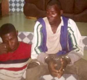 The driver with his mate at the Gbewaa Palace