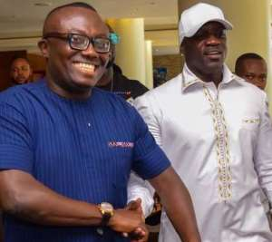 Akon (right) in a pose with Bola Ray