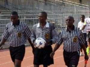 Three referees put on ice