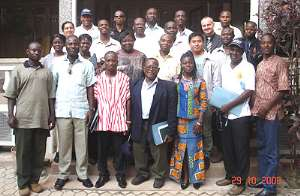 A group photograph of project managers and staff members of IICD