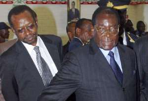 Zimbabwean President Robert Mugabe (R)  (AFP/Getty Images)