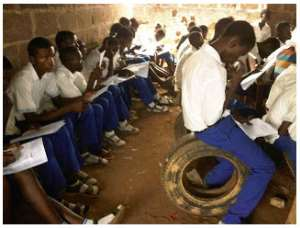 Students of Ajuwon High School, Akute,in Ogun State during exam