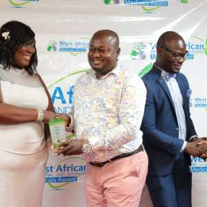 Dr. Kennedy Agyemang, Chief Executive Officer of Kenoga Company Limited with his award