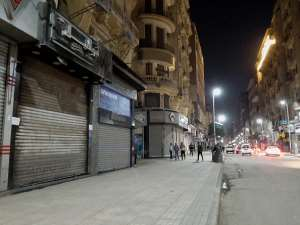 A deserted street in Cairo after the government ordered the closure of shops, restaurants and cafes. - Source: Photo by Ziad Ahmed/NurPhoto via Getty Images