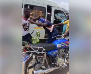 Photo: Police officer fends off blows from the driver and his mate