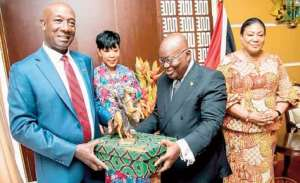 President Akufo-Addo presenting a gift to Prime Minister Dr. Keith Rowrey