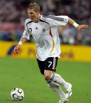 Germany's Bastian Schweinsteiger controls the ball during the World Cup 3rd place soccer match between Germany and Portugal at the Gottlieb-Daimler st