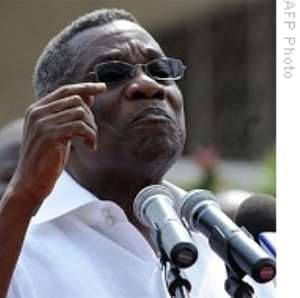 Government to review draft oil law -- Mills