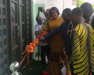 Minister of Tourism, Babara Oteng-Gyasi cuts the tape to open the canteen