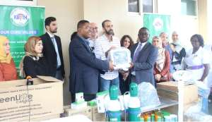 Ahmed Dayekh (middle) handing over the items to the management of KBTH