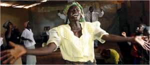 An African woman speaking in tongues