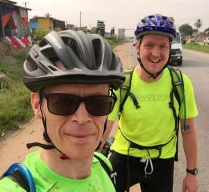 British High Commissioner to Ghana, Iain Walker and a friend cycling