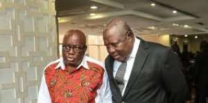 Martin Amidu, Special Prosecutor in suit and President Akufo Addo in a conversation after his swearing in