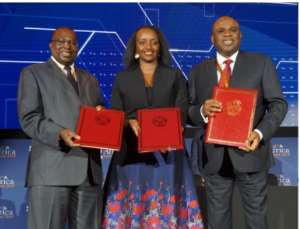 Albert Muchanga, Commissioner for Trade and Industry, African Union (left); Soraya Hakuziyaremye, Minister of Trade and Industry of Rwanda (centre); and Afreximbank President Prof. Benedict Oramah with the hosting agreement following the signing ceremony in Kigali.