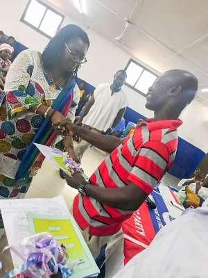Ablekuma West MP, Ursula Owusu handing over car documents to a beneficiary of the taxi scheme
