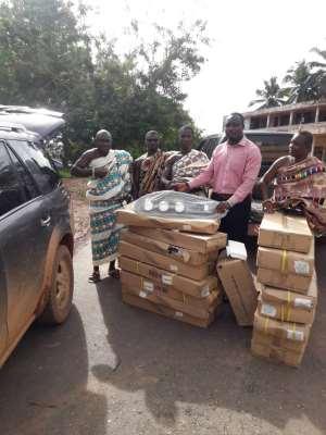 Nzema East MCE Gives Streetlights To Communities