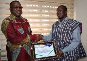 Mr Abdallah Musah (right) of the Humanity Magazine International presenting the award to Dr. Ben. KD Asante (left)