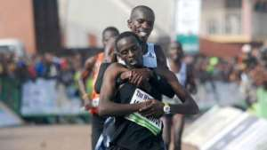 Kenyan Runner Gives Up On Winning Race To Rescue Collapsing Rival [PHOTOS]