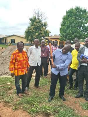The Municipal Chief Executive Dr Prince Kwakye Afriyie breaking grounds for work to commence