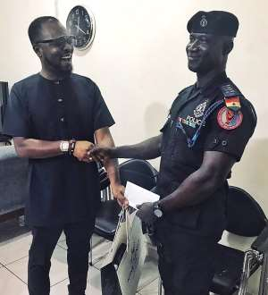 [Photos] KOD Rewards Police Officer Who Saved Lives During The Floods