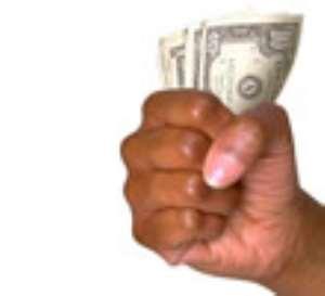 Dollar Power Controls Ghanaians
