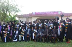 The graduates in a group photograph with dignitaries after the ceremony