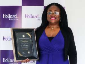 The Group Chief Executive Officer (CEO) of Hollard Ghana, Patience Akyianu showcasing her award