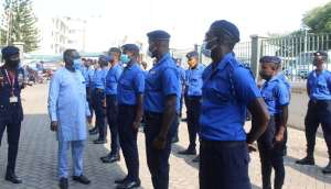 Dr. Daniel Asare inspecting the security in their new uniform