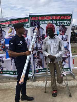 Police Officer Supports The Physically Challenged