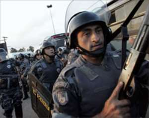 Brazil probes police role in gang riots