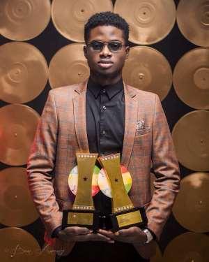 Kuami Eugene aka Rockstar showcases his awards after the 2020 VGMA