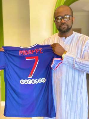 GFA President Kurt Okraku in a pose with his signed PSG jersey