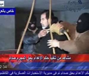 Mixed emotions, celebrations follow Saddam's death