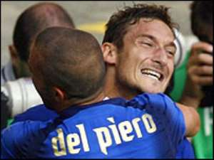 Totti celebrates after snatching a dramatic last-gasp win for Italy