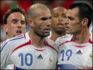 Zidane celebrates with his team-mates after the winning penalty