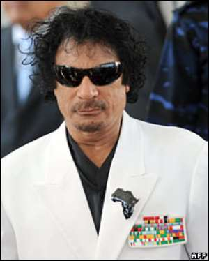 Col Gaddafi seems to have a fresh outfit for every occasion